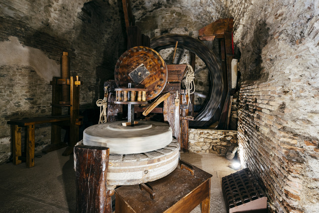 Grinding stones in a water mill for grinding grain
